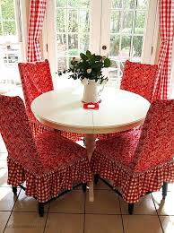 ikea round dining table and chairs white love the red chair covers are gorgeous this is a very homey atmosphere australia