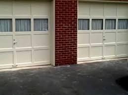 repair garage door panels don t replace them you and wood garage door