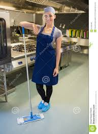 Kitchen Floor Cleaners Smiling Woman Cleaning The Kitchen Floor Royalty Free Stock Image