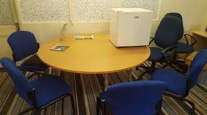 large office table. Large Round Office Table And Blue Chairs. As New, Chairs Slightly Worn, Also Small Fridge.
