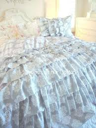 fleur de lis bedding set french ruffles gray with white signer sign reverses to hot pink with ruffle pillow shams to accent the set in queen full or twin