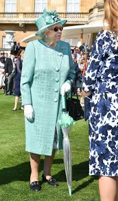 the queen arrives for her special garden party