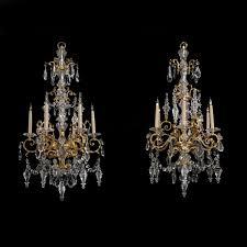 a fine pair of cut glass and gilt bronze six light chandeliers