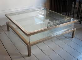 glass and wood coffee tables uk an articulated display coffee table worn chrome on brass