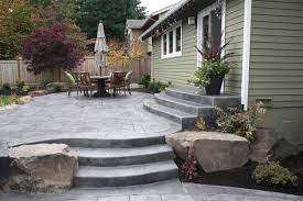 be sure to incorporate natural elements into your landscape curved concrete patio