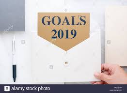 Gold Card Office Top View Of Hand Holding White Envelop With Goals 2019 New