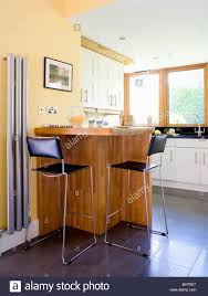 Kitchen Radiator Black And Chrome Stools At Breakfast Bar In Modern Kitchen With