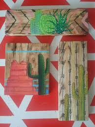 cactus painting on repurposed pallet wood wall art 10 75 x 3 25 with arrow and chevron background