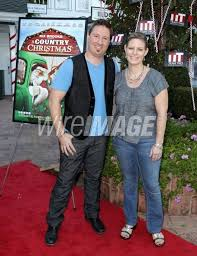 Director Dustin Rikert and Lori at A COUNTRY CHRISTMAS movie premiere at  the DeMille Theatre at Culver Studios. | Movie premiere, Christmas movies,  Premiere