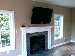 tv above fireplace hiding wires above fireplace wires wall mount over fireplace hide cables install above brick stand white mosaic granite accent mantel