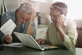 Image result for stressed out couple looking at bills
