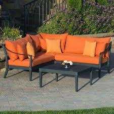 astoria 4 piece patio sectional seating set with tikka orange cushions