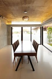 contemporary house furniture. Stunning Interior Descor Using Long Wooden Dining Table On White Glossy Tile Floor Completed With Hanging Contemporary House Furniture S
