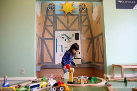 mya lucas 5 of keizer plays near a model of the union street pedestrian bridge in a new exhibit m station at the gilbert house children s museum in