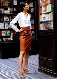 one of my favourite things i own is a black leather pencil skirt but i love this rust colored leather skirt a lot