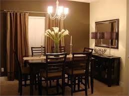 dining room and office. chocolate brown dining room with red tonesoffice or and office