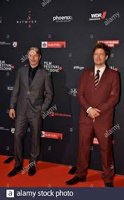 Cologne, Germany. 04th Oct, 2020. The actor Mads Mikkelsen (l) and director  Thomas Vinterberg (r) comes to the screening of the film