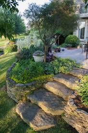 nice perennial garden but the star here is the fantastic flagstone steps &  flat stack retaining wall eeek i so want to do this from patio to yard!