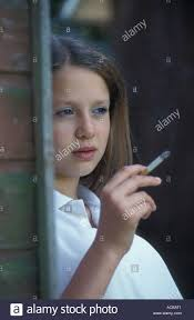 Teen girls smoke cigarettes