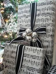 Can't get enough of that sheet music gift wrap! Love this too! If you can't  find sheet music wrapping paper take favorite sheet music of holiday songs  to ...