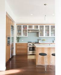 kitchen cabinet door trim: this kitchen is modern and lovely with its shaker front cabinets and blue glass tile backsplash i love the upper cabinet doors with their framed brushed