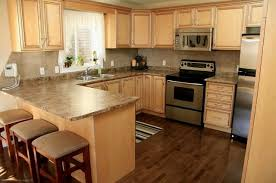 dark wood floors with maple cabinets