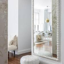 wall mirrors for living room. White Moroccan Leather Pouf With Herringbone Jute Rug Wall Mirrors For Living Room