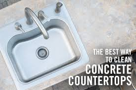 concrete countertop with metal sink