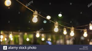 Party String Lights Hanging Over Outdoor Restaurant Terrace