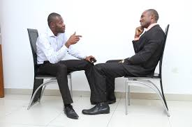 job hunting in use these tips to improve your chances image of a job applicant and an interviewer