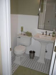 bathroom interesing small bathroom with white beadboard wainscoting and square padestal sink along with wide vertical rectangular mirror