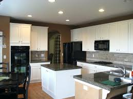 kitchen colors with black appliances bronze single hole faucet kitchens with black appliances and white cabinets