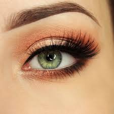 image result for makeup that matches navy blue dress orange eyes