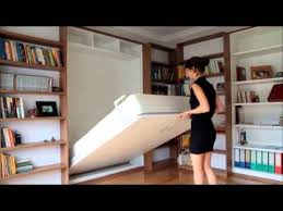 sliding bookcase murphy bed. Wonderful Bookcase Wall Bed Folded Behind Sliding Bookshelves With Sliding Bookcase Murphy Bed Y