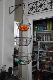 You'll love the homespun look of our Wire Three-Tier Hanging Basket and the  way it adds an Americana splendor to your kitchen decor.