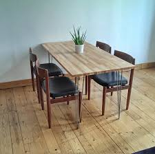 ikea stockholm furniture. vintage wooden ikea stockholm dining table with decorative black chairs set close to plain soft blue wall paint color furniture
