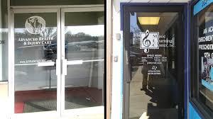 two glass door signs