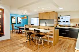 Trendy l-shaped eat-in kitchen photo in Denver with stainless steel  appliances,