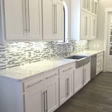 glasosaic tile backsplash white kitchen cabinets