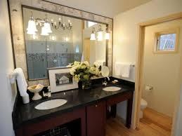 dark brown wooden bathroom vanity with black granite top added by