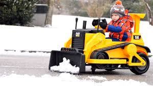 3-year-old boy gets rid of neighborhood snow one driveway at a time