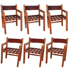 set of six wood and woven saddle leather dining chairs for