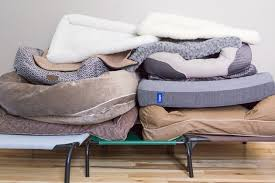 twelve of the diffe dog beds we tested stacked on top of one another