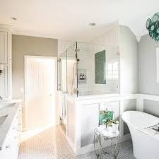 gray and blue bathroom with aqua glass chandelier over tub