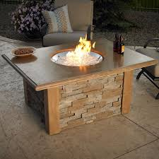 the sierra fire pit table round burner by the outdoor greatroom company a simple push of a on starts the sierra fire pit table round burner from the