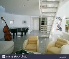 Grand Piano And Bassviol In Large Modern Living Room With Cream - Livingroom deco