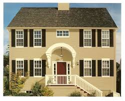 exterior paint color combinations with stone. exterior paint color combinations. the butter cream with black shutters and reddish brown door. combinations stone