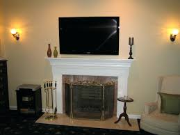 mounting tv over brick fireplace hiding wires install on rock above cables fireplce
