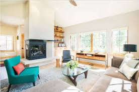 blue couch and brown sofa for beautiful living room with fireplace