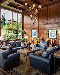 a nature inspired chandelier beautiful artwork and floor to ceiling windows and stunning photography of the olympic peninsula by local photographer